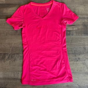 Nike Dri-fit pink soft tee with air holes in back.